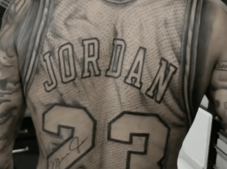 Fan gets Michael Jordan jersey tattoo on his back!