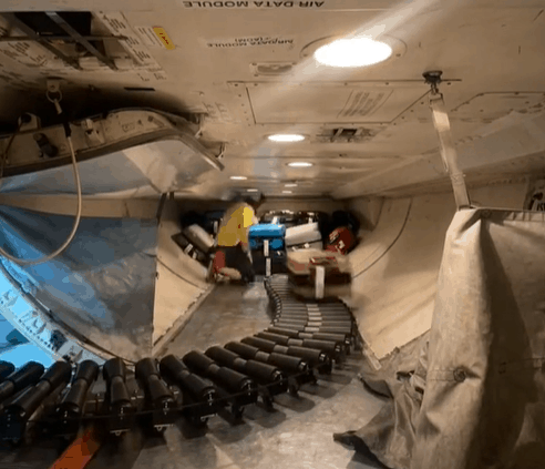 Stephen Linson shows how luggage is loaded onto an airplane on TikTok
