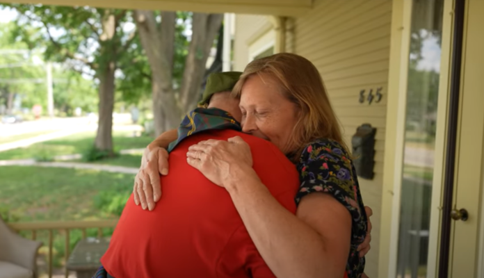 Marine Corps veteran steps out of wheelchair to surprise wife